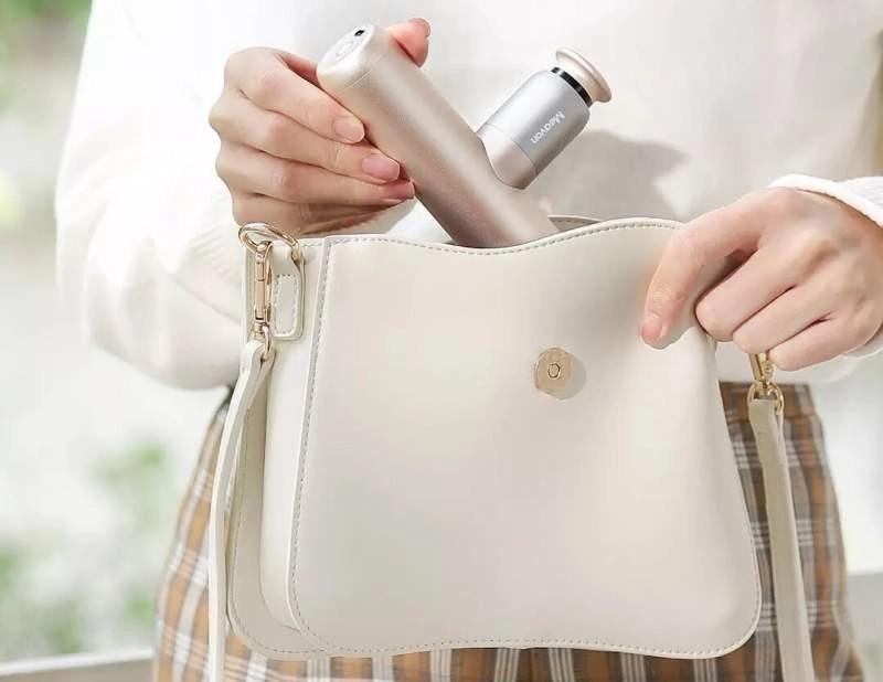 Pistola de masaje Xiaomi Mini en bolso